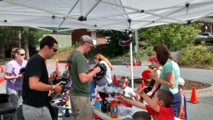 Charlie Charping and Jason Selong helping out at the bike rodeo at Emergency Fest May 30.